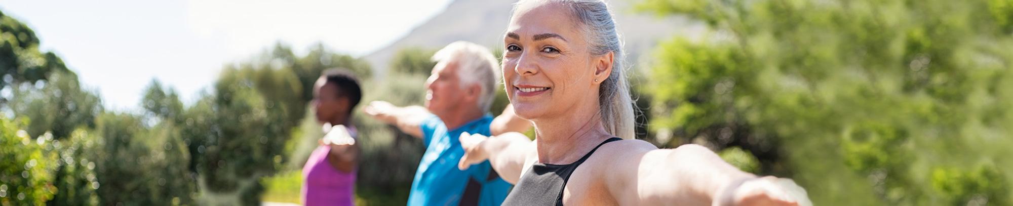 Woman doing yoga looking at camera